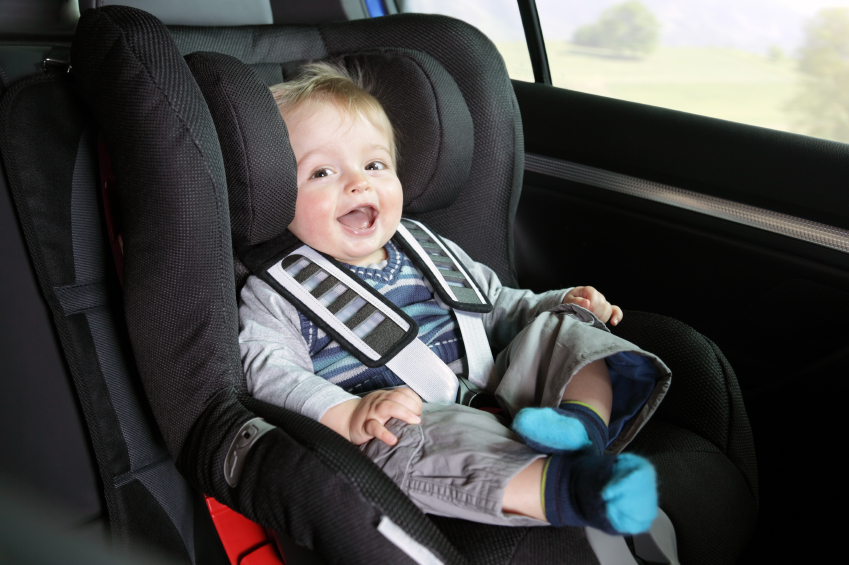 Baby boy in a child safety car seat - Baby Zone and Beyond